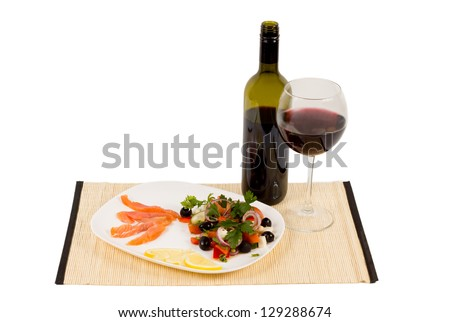 Healthy gourmet meal of sliced salmon served with a fresh mixed salad and red wine - stock photo