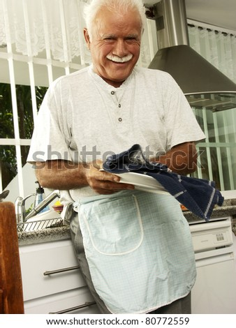 Healthy grandfather working in a kitchen.A - stock photo