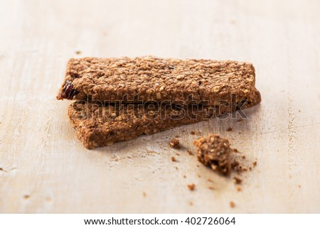 Healthy granola bars on wooden table
