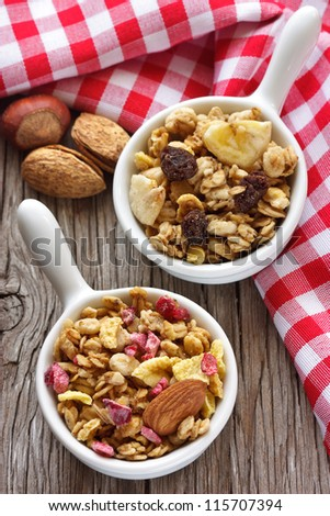 Healthy granola cereal with nuts and berries. - stock photo