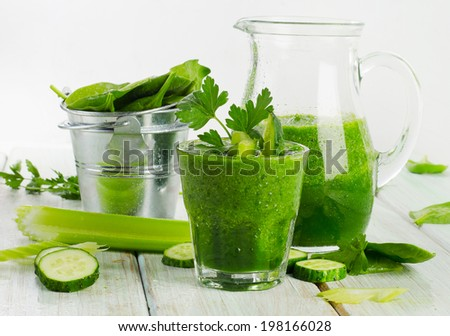 Healthy green smoothie in a glass.  Selective focus - stock photo