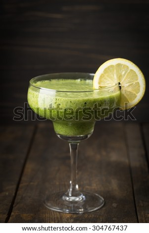 Healthy green smoothie in a margarita glass