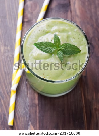 Healthy green smoothie on the wooden table