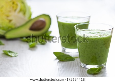Healthy Green Smoothie on Wooden table - stock photo