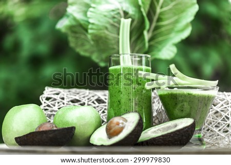 Healthy green smoothie with fresh fruits and vegetables. - stock photo