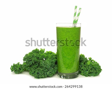 Healthy green smoothie with kale in a glass with straws isolated on a white background - stock photo