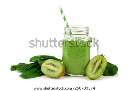 Healthy green smoothie with spinach and kiwi in a jar mug isolated on white - stock photo