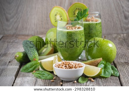 healthy green smoothie with sprouts on a wooden table, close-up - stock photo