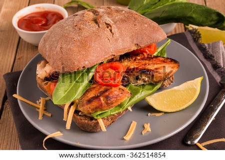 Healthy Grilled Chicken Sandwich with Tomatoes, cheese and Spinach - stock photo