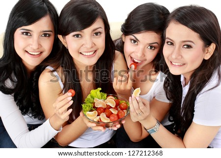 healthy group of attractive woman having fresh salad together