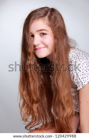 Healthy hair of lovely teenager - stock photo