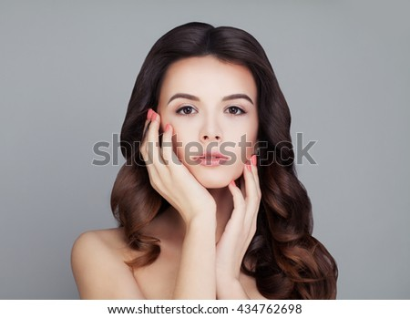 Healthy Hair Woman. Shiny Curly Hairstyle. Skin and Haircare Concept - stock photo