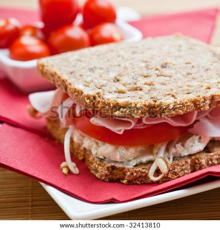 Healthy ham, cheese and tomato sandwich with bean sprouts