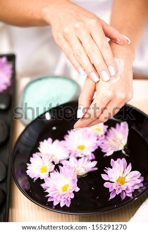 Healthy Hands.Female applying moisturizer to her Hands - stock photo