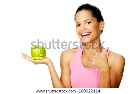 Healthy happy hispanic woman with apple and tape measure for diet and weight loss concept - stock photo