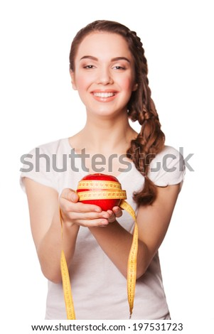 Healthy happy woman with apple and tape measure for diet and weight loss concept