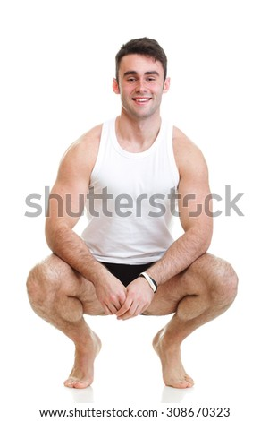 Healthy happy young man with towel isolated on white background