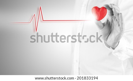 Healthy heart and cardiology concept with a cardiogram linked to red heart. - stock photo