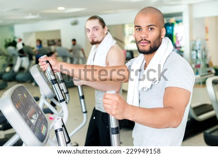 Healthy Heart pledge life. Portrait of a confident athlete to exercise in the cardio room. Two athletes engaged in the simulator gym - stock photo
