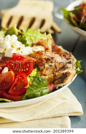 Healthy Hearty Cobb Salad with Chicken Bacon Tomato Onions and Eggs