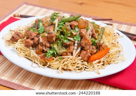 healthy home made chicken chow mein or chow mien with crispy noodles - stock photo