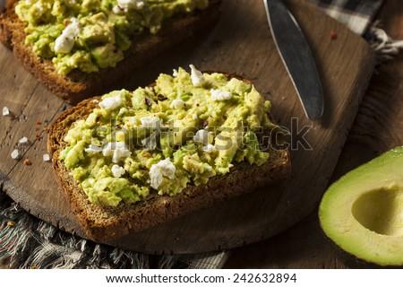 Healthy Homemade Avocado Toast with Salt and Feta - stock photo