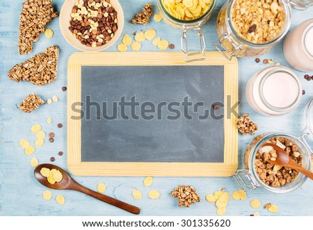 Healthy homemade granola or muesli with toasted oats, cornflakes, yogurt. Health and diet concept. Vintage blackboard with copyspace - stock photo