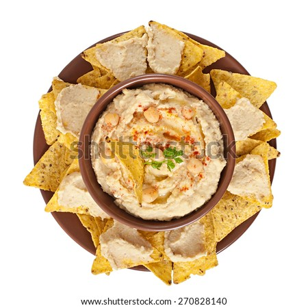 Healthy homemade  hummus with olive oil and pita chips isolated on white background - stock photo
