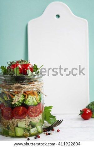 Healthy Homemade Mason Jar Salad with Quinoa and Vegetables - Healthy food, Diet, Detox, Clean Eating or Vegetarian concept - stock photo