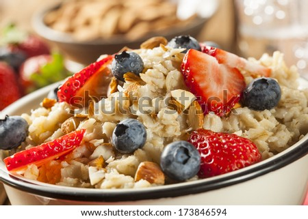 Healthy Homemade Oatmeal with Berries for Breakfast - stock photo