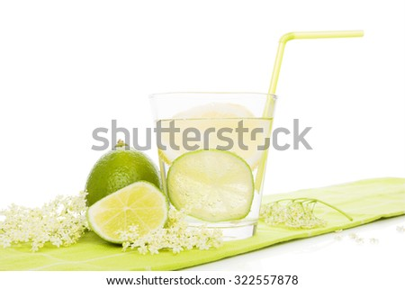 Healthy homemade organic elderberry lemonade with lime slices isolated on white background. Refreshing seasonal nonalcoholic summer drink. - stock photo