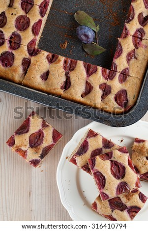 Healthy homemade spelt zucchini cake with plums. Shallow dof - stock photo