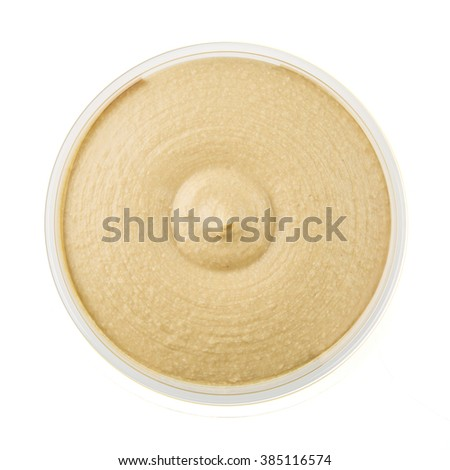 Healthy hummus in container from above and isolated on a white background. - stock photo