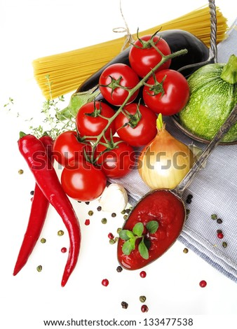 healthy italianspaghetti with tomatoes and vegetablel on a white background - stock photo