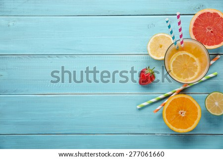 Healthy juice and fresh fruits on wood background - stock photo