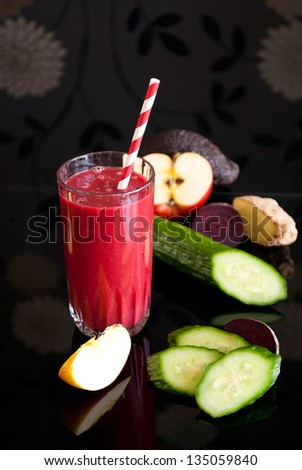 healthy juice made of variety fresh organic fruits and vegetables