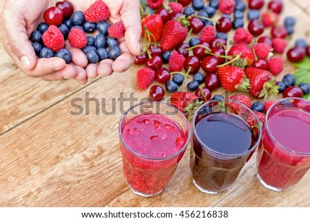 Healthy juice made with fresh, organic wild berries - stock photo