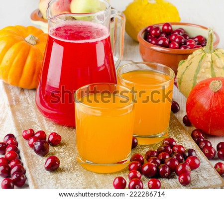 Healthy juice with  autumn fruit and vegetables. Selective focus - stock photo