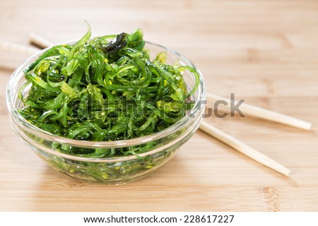 Healthy Kelp Salad in a bowl on wooden background (close-up shot)