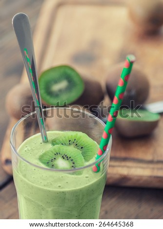 Healthy kiwi smoothie in a glass. Selective focus, shallow DOF - stock photo