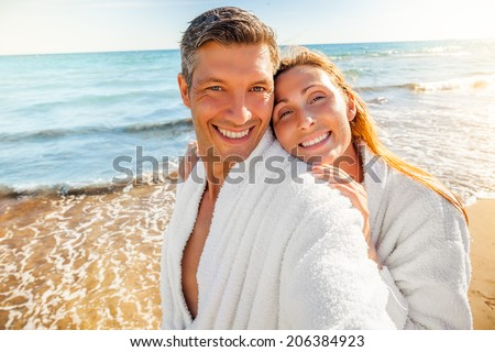 healthy laughing people on tropical wellness spa hotel in bathrobe