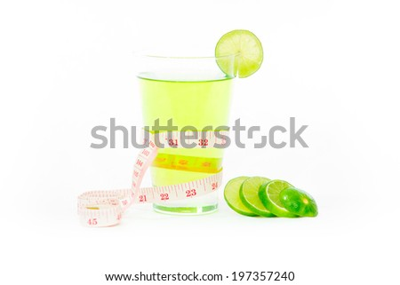 Healthy lemonade juice with tape measure on a white background. - stock photo