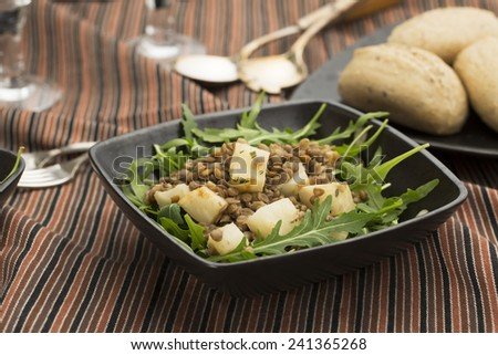 Healthy lentil and celeriac salad on rocket lettuce - stock photo
