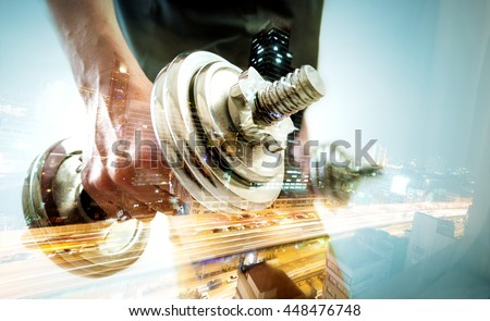 Healthy life and gym exercise.Gym equipment and sport concept.Double exposure background.Dumbbells.