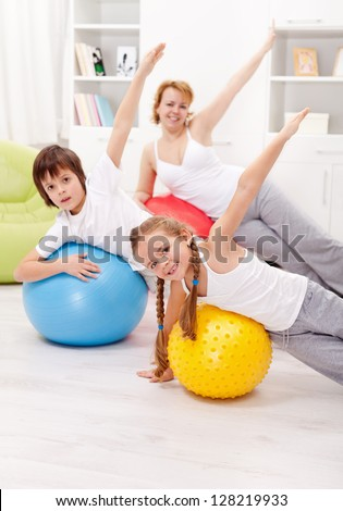 Healthy life concept with exercising people on large gymnastic balls