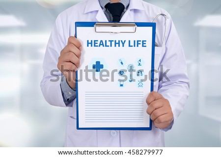 HEALTHY LIFE Portrait of a doctor writing a prescription