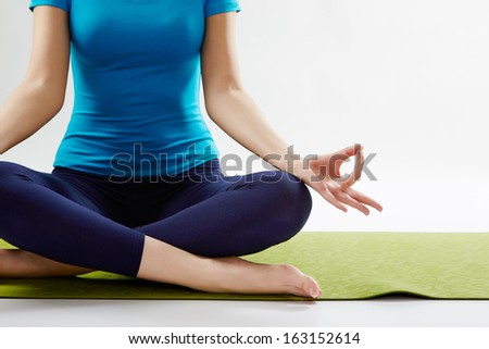 Healthy life. Young  woman doing yoga isolated on white background. - stock photo