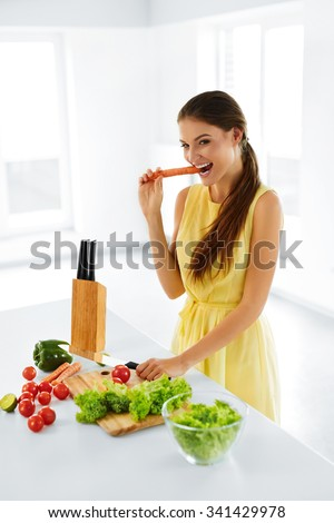 Healthy Lifestyle And Diet. Portrait Of Happy Smiling Woman Preparing Fresh Organic Food In Kitchen, Cooking Vegetarian Salad. Healthy Food And Eating.  Healthcare. Health, Beauty Concept. Nutrition. - stock photo