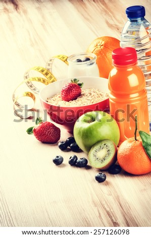 Healthy lifestyle and fitness concept. Fresh fruits, juice and cereal  - stock photo
