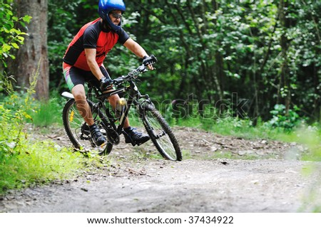 healthy lifestyle and fitness concept with mount bike man outdoor - stock photo